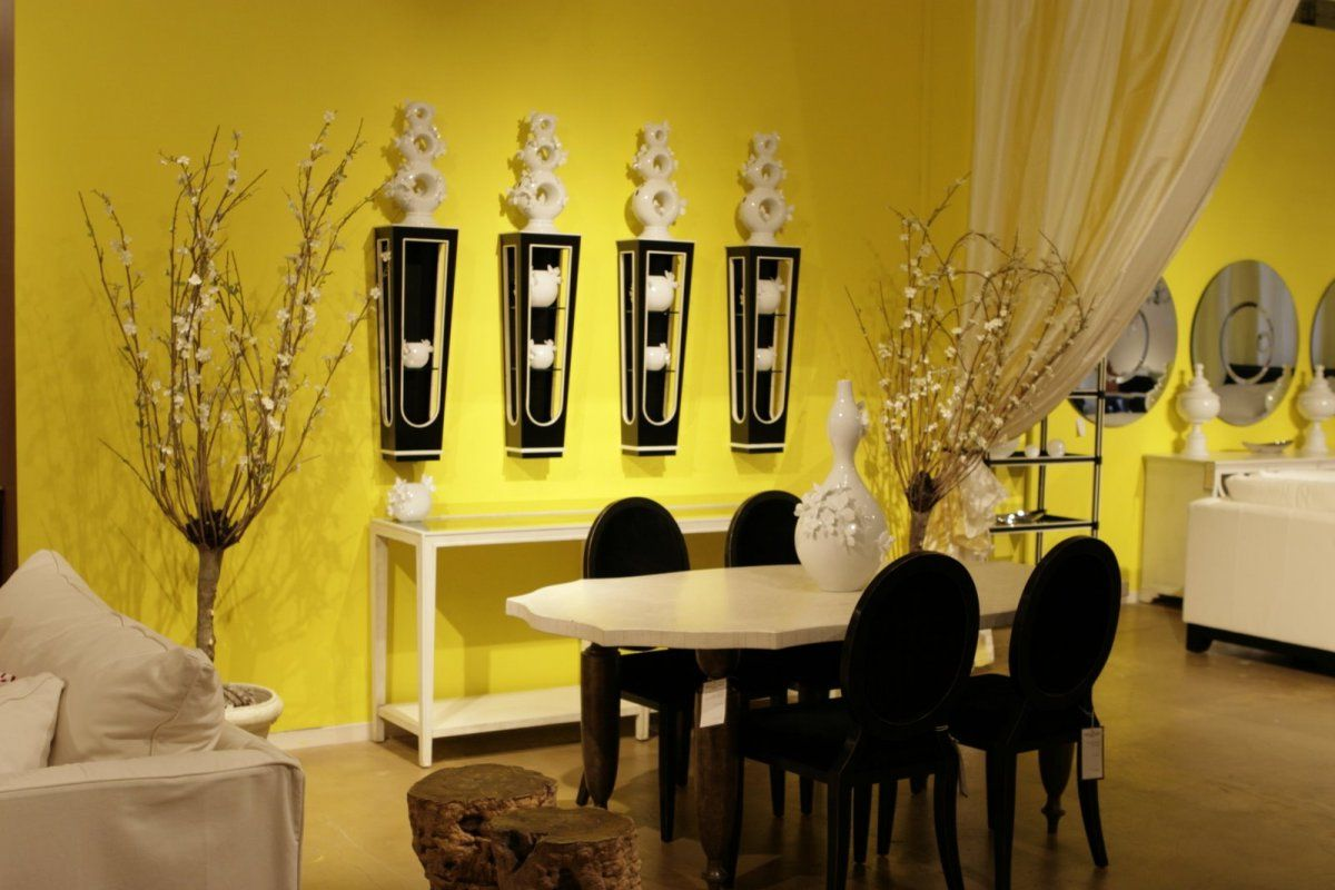 Fancy Yellow Dining Room With Unique Wall Decors